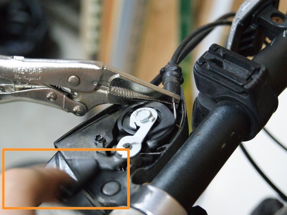 Trick: use pliers or vise grips to hold the cable in front of the shifter mechanism.