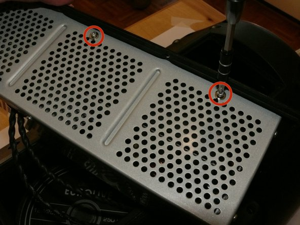 Image 1/3: There are '''five of the same type of machine screw (silver, 6 mm-long)''' remaining around the metal electronics box's exterior; remove these as well.