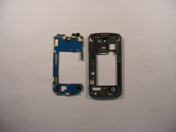 Using your fingers, grab onto the blue motherboard and safely remove the loosened motherboard from the device.