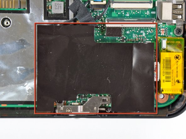 If present, carefully remove the large piece of black adhesive film covering the Wi-Fi board.