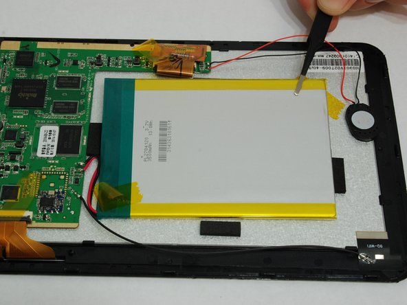Once the tape has been removed, the battery will be free from the tablet except for the wired connections to the circuit board.