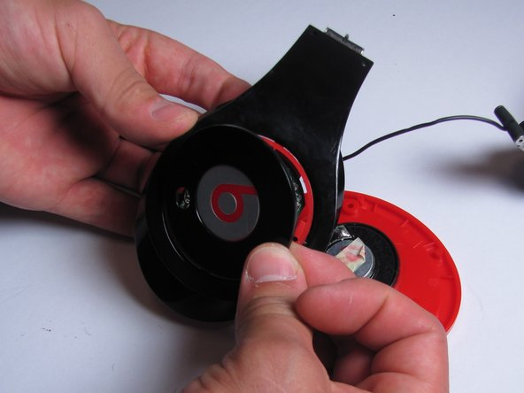 Image 1/2: Simply lift the cover with the beats logo off.