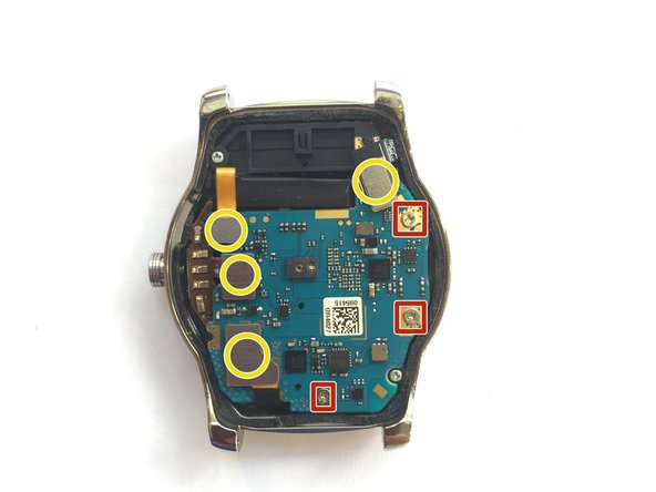 Using a PH000 screwdriver, remove the three screws in order to release the motherboard from the watch.