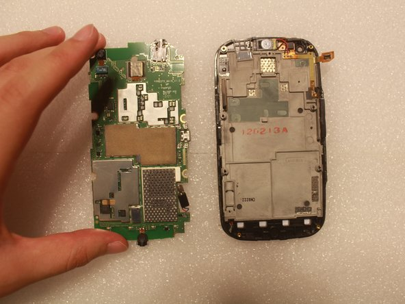 Beginning with the side with the USB port may damage the phone.
