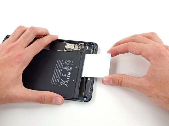 Push the card further underneath the battery.