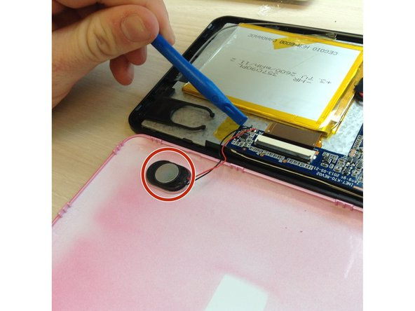 Slowly flip open the pink back cover and gently remove the speakers from it with a plastic plier.