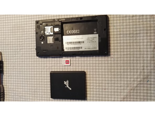 Image 2/2: Remove the MicroSD card by pushing up from the bottom until it clicks. It will then ping down.