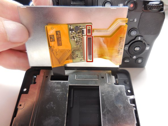 Unplug the ribbon cables on the side of the chip under the LCD by simple pulling lightly on them.