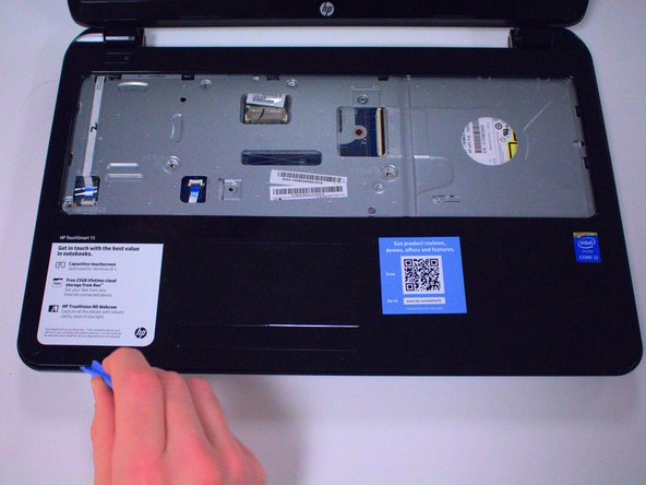 Use your plastic opening tool to pry the base of the laptop off.