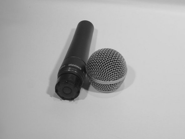 Completely unscrew the grille and slide it off of the top of the microphone. The unprotected microphone is delicate, so place it somewhere safe while you follow the next steps.