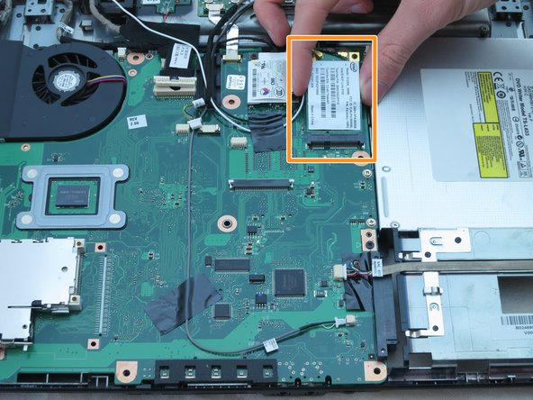 Image 2/2: Be careful not to allow either fastener into the CPU fan and duct (located in the upper left).