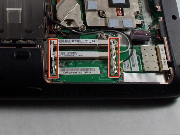 Pull the release latches outward. The memory module should lift up.