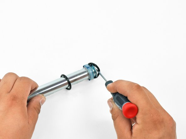 Image 1/2: Use the screwdriver to remove the upper bump stop O-ring.