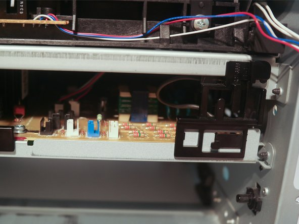 Disconnect 2 cables from the control board and remove them from the cable guide.