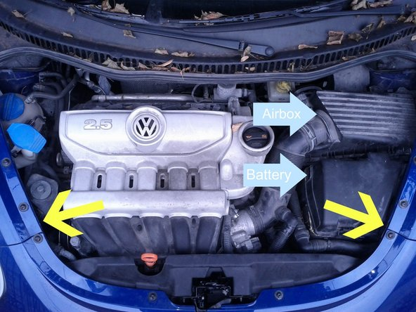 Then open the hood by pulling the plastic tab toward you and lifting the hood.