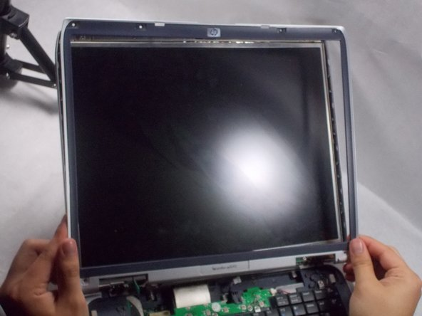 Using a spudger, pry the plastic casing off of the screen.