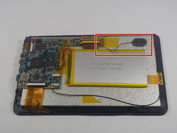 With the back cover removed from your tablet locate the speaker and the speaker wires shown in the red box.