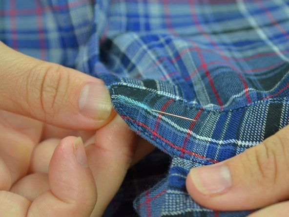 Image 1/3: Pull the thread taut, until the knot catches the backside of the fabric.
