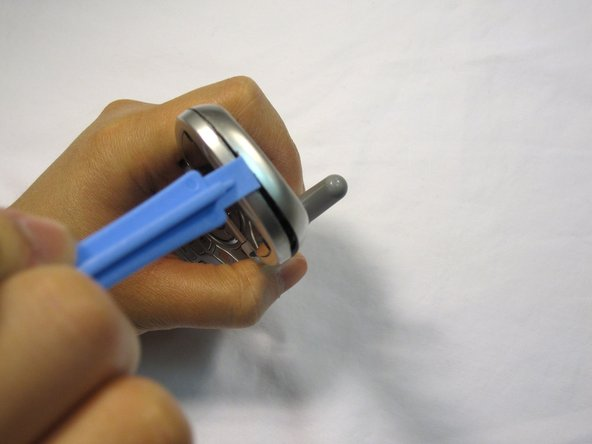 Image 2/3: Move the opening tool around the perimeter of the seam and gently take the front LCD face plate out.