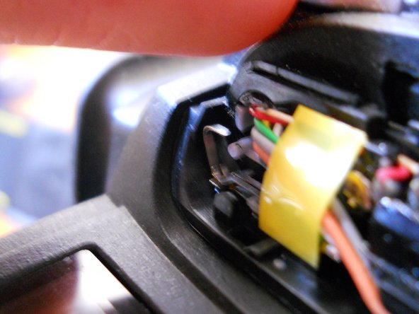 Image 2/3: CAUTION: Do not touch any metal on the camera while repairing the flash.   Even though the battery is removed, the capacitor can give you quite a zap. not break the insulation of a wire as both could electrocute you. Also, be very careful not to damage any wires.