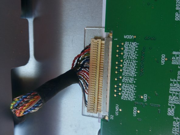 Hold right below the cables and pull the cable apart from the top circuit board