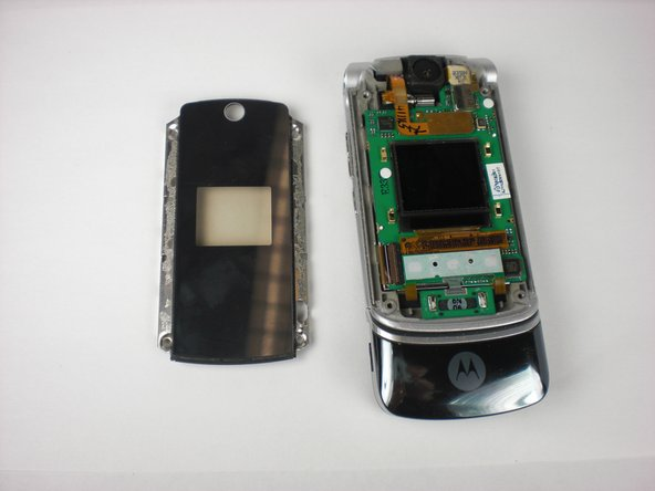 The touch-sensitive keys and chip board/LCD screen (which is green) may remain attached to the face plate because of the glue.