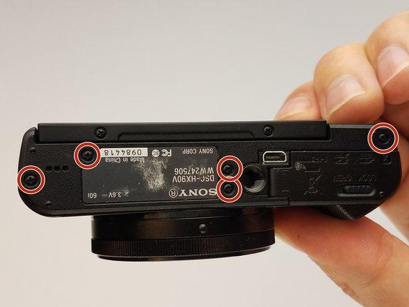 Lege das Gerät so, dass die Unterseite der Kamera nach oben zeigt.