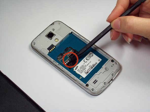 Image 1/2: Remove Memory Card using a tweezer or fingers