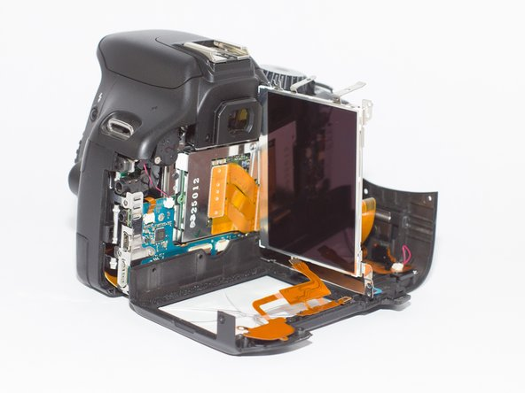 Lift the broken screen and remove it. Then replace the new screen and attach the tabs that were removed in step 5. Replace the battery and turn on the camera to make sure it works.