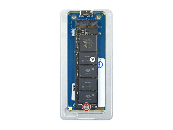 Use a T5 Torx driver to install the 6.5 mm screw securing the bottom of the SSD.