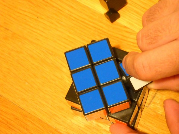Image 2/3: Push the pieces up until they pop out of the cube, then, slide the rest out