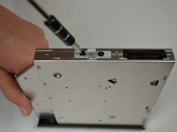 Image 2/2: Remove the rectangular metal plate.