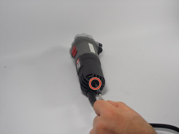 "Using the Phillips #2 screwdriver, remove the 3/4"" screw on the back cover."