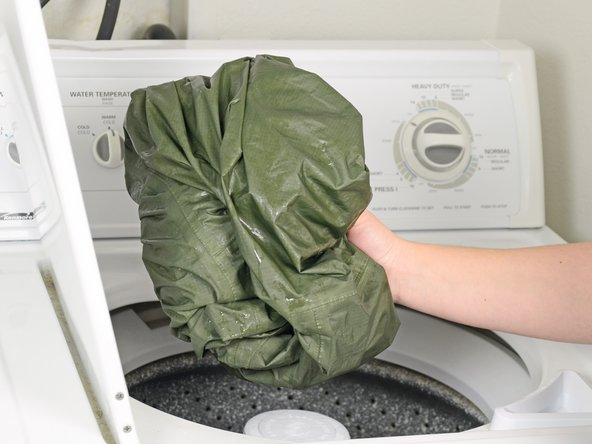 Take the jacket out of the washer.