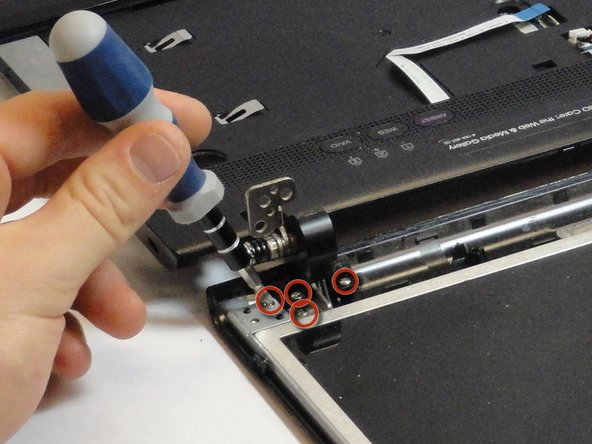 Use a Phillips #00 screwdriver to remove  the four 5.65-mm screws on each bottom corner of the display.
