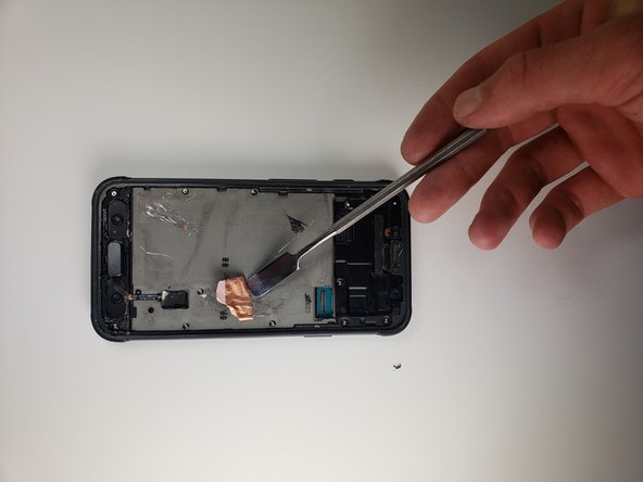 Clean the rest of the adhesive left on the phone by scraping it off with a metal tool.