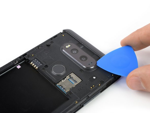 Use the tip of an opening pick to gently pry up the rear lens cover.