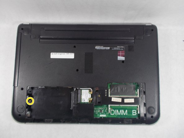 Now remove the single screw that is securing the hard drive to the laptop noted by the red circle