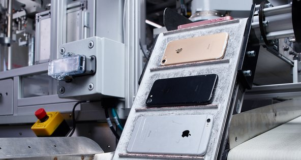 iPhones going through Apple's recycling robot Daisy
