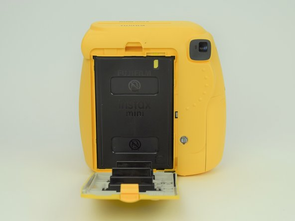 Remove the film cartridge within this compartment.