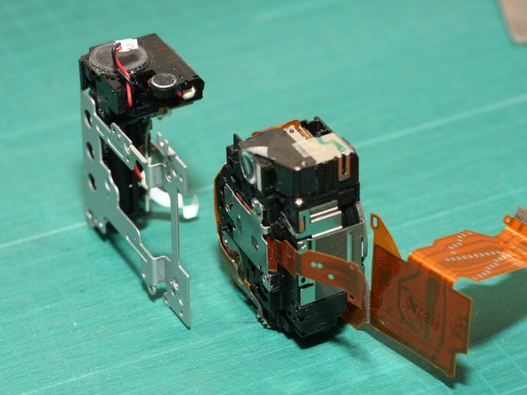 2nd photo: After removing the screws, you can separate the electronic flash module (left) from the lens module (right)