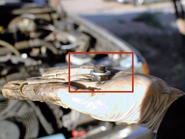 Shown here is the coolant drain bolt from the block. Plan to replace the washer after removal.