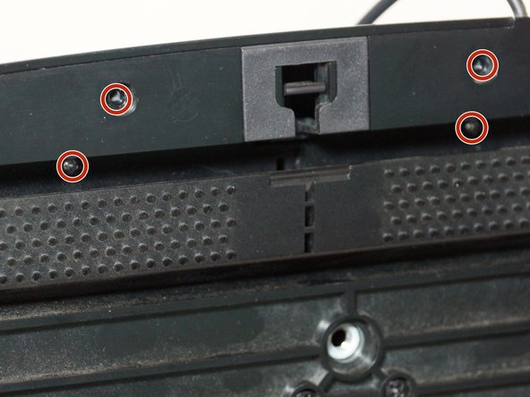 There are two of these screws under the carpet grip, make sure you don't miss those!