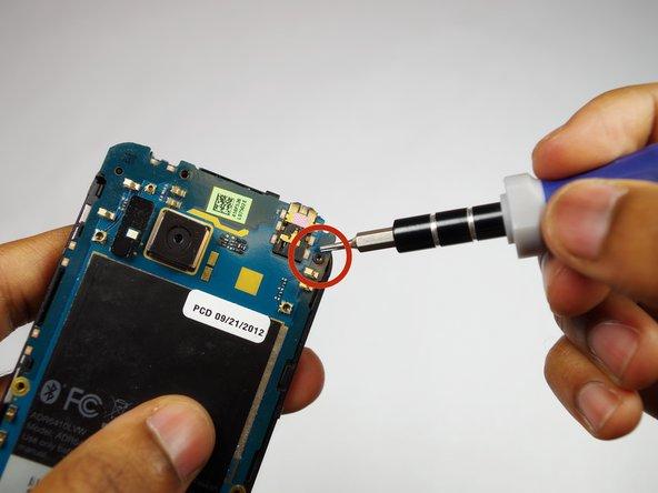 Remove the 4mm Torx screw.