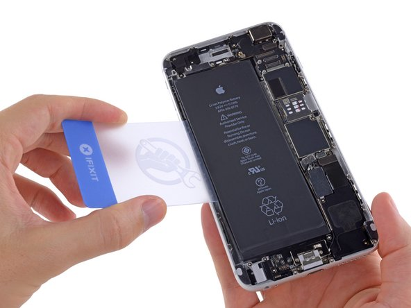 Image 1/1: Don't pry under the topmost section of the battery, near the volume up button and mute switch, or you may damage the [https://www.ifixit.com/Guide/iPhone+6+Plus+Audio+Control+and+Rocker+Switch+Cable+Replacement/31183#s74381|audio controls cable|new_window=true], which is adhered to the rear case just beneath the battery.