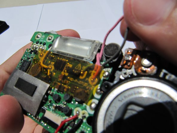 Remove the capacitor (attached by adhesive) and desolder.