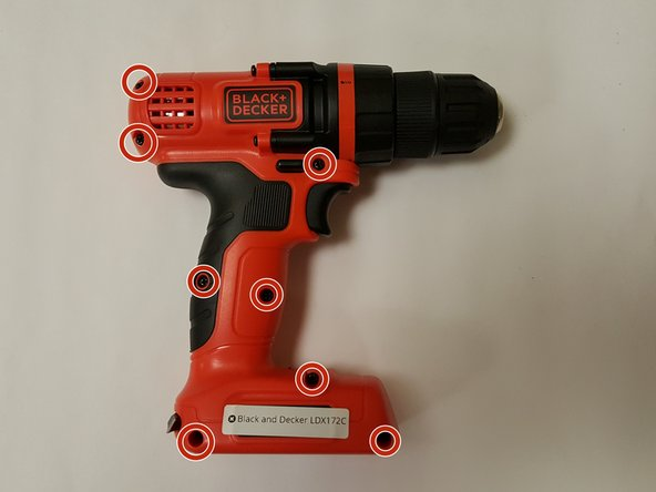 Rotate the drill to it's left side - the chuck should be facing to the right. Locate and remove the eight #2 X 5mm Phillips fasteners from the body of the drill.