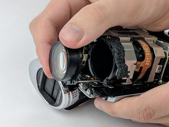 Gently remove the lens.