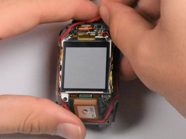 The waterproofing seal is the red, elastic band that surrounds the display of the watch.