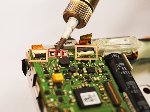 At the bottom of the motherboard, there are four nodes. With the soldering iron, desolder the metal nodes to release the wires from the board.